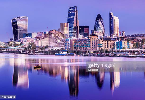 downtown london city skyline reflection in river thames at night - downtown stock pictures, royalty-free photos & images
