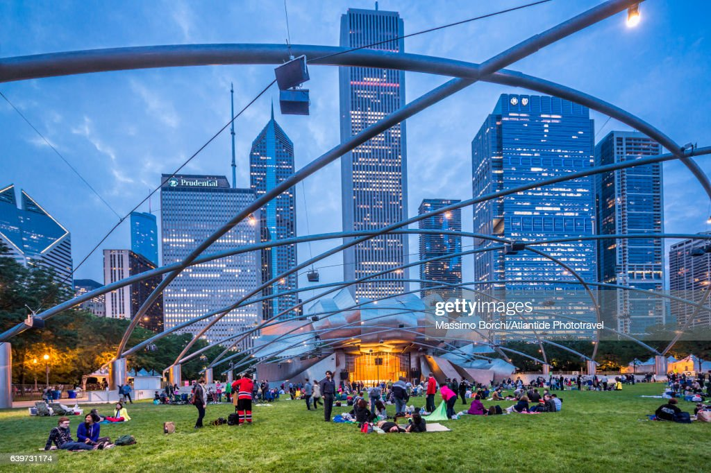 Downtown, Loop, Millennium Park, people near the Jay Pritzker Pavilion, a bandshell designed by Frank Gehry : Stock Photo