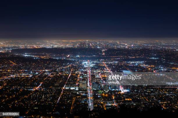 downtown los angeles and glendale at night - san fernando california stock photos and pictures