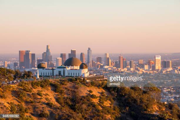 downtown los angeles and griffith observatory at sunset - hollywood hills stock pictures, royalty-free photos & images