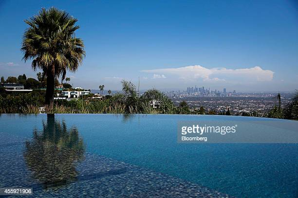 Downtown Los Angeles is seen from the infinity pool outside 1181 N Hillcrest Road at Trousdale Estates in Beverly Hills California US on Wednesday...