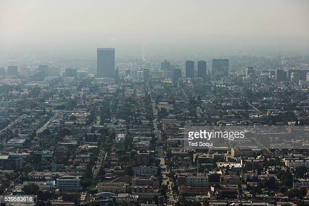 Downtown Los Angeles with an inversion layer of smog SB 350 signed in to law California Governor Jerry Brown signing SB 350 the climate and clean...