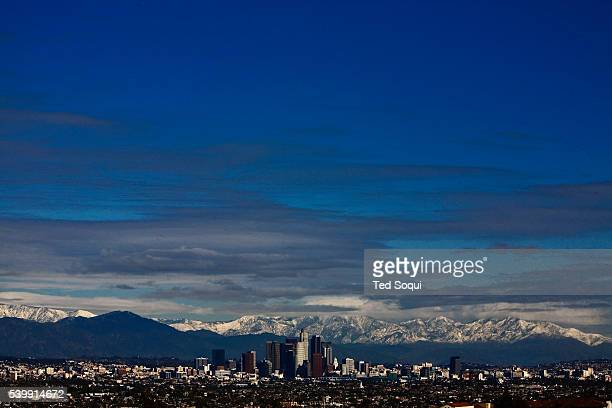 Downtown Los Angeles with snow covered Mount Baldy of the San Gabriel Mountain Range in the background