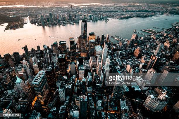 downtown lower manhattan skyline overlooking the jersey city, taken from a helicopter, with one world trade center towering over other skyscrapers - jersey city stock pictures, royalty-free photos & images