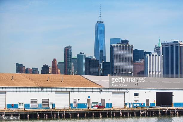 downtown manhattan and freedom tower and old warehouse