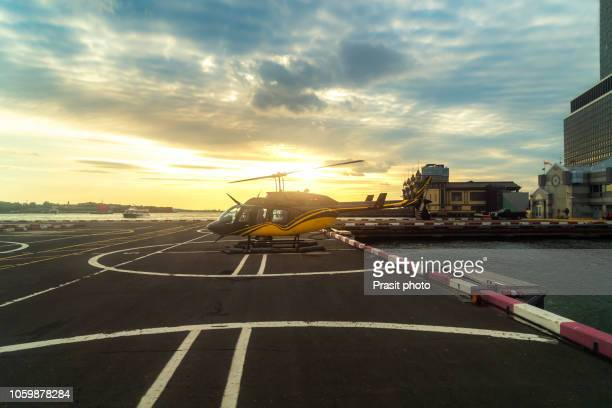 downtown manhattan heliport is a heliport in lower manhattan, outstanding in the east river, new york, usa. - helipad stock photos and pictures