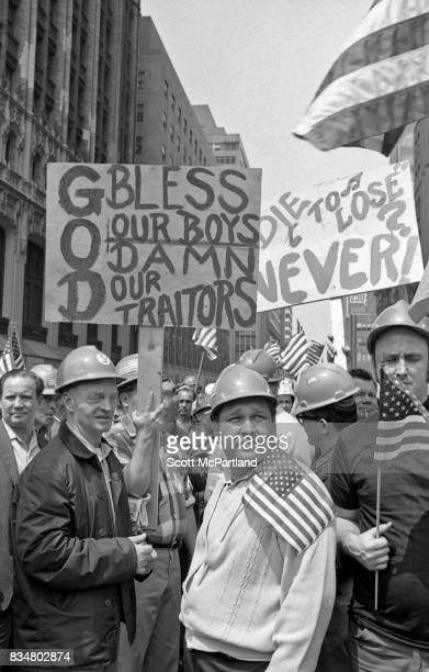 Downtown Manhattan May 1970: World Trade Center construction workers and war veterans alike protest Mayor Lindsey's decision to lower the American...
