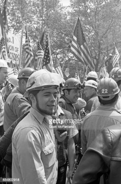 World Trade Center construction workers and war veterans alike protest Mayor Lindsey's decision to lower the American Flags in memory of the victims...