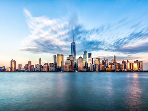 Downtown manhattan new york jersey city golden hour sunset 910867946