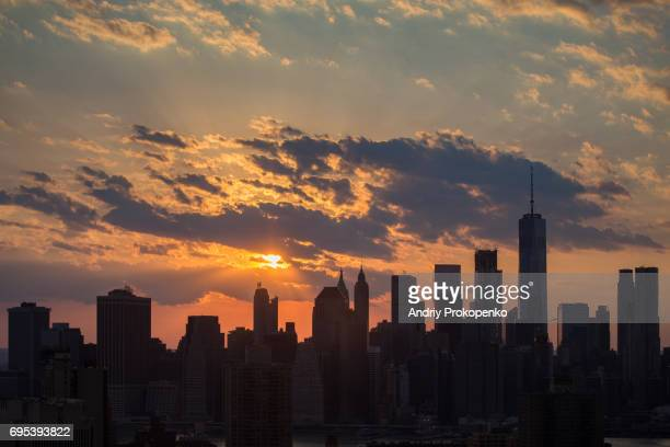 Downtown Manhattan silhouette at sunset
