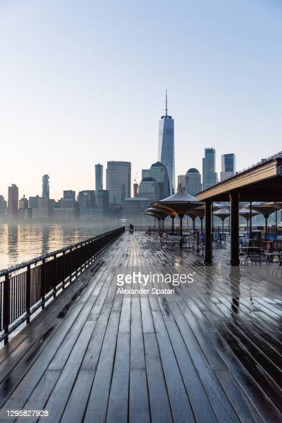 downtown manhattan skyscrapers in new york city seen from jersey city, usa - manhattan new york city stock pictures, royalty-free photos & images