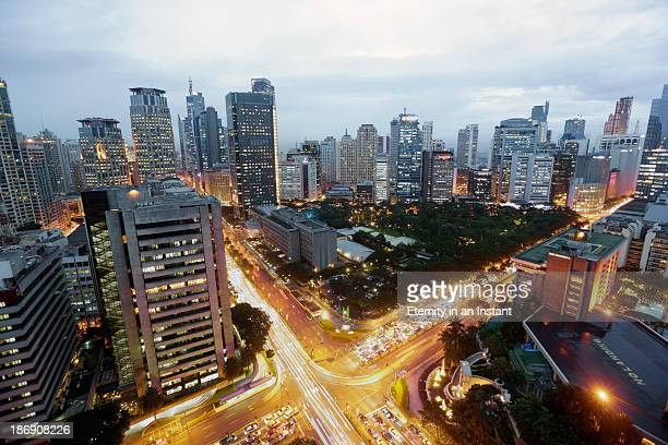 downtown manila  makati skyline and traffic - makati stock photos and pictures