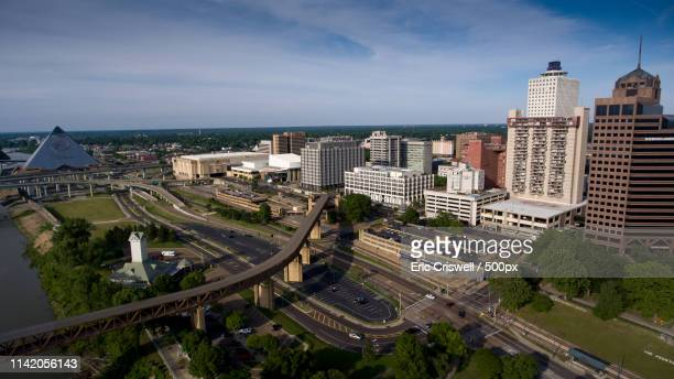 downtown memphis from the air - memphis bridge stock photos and pictures