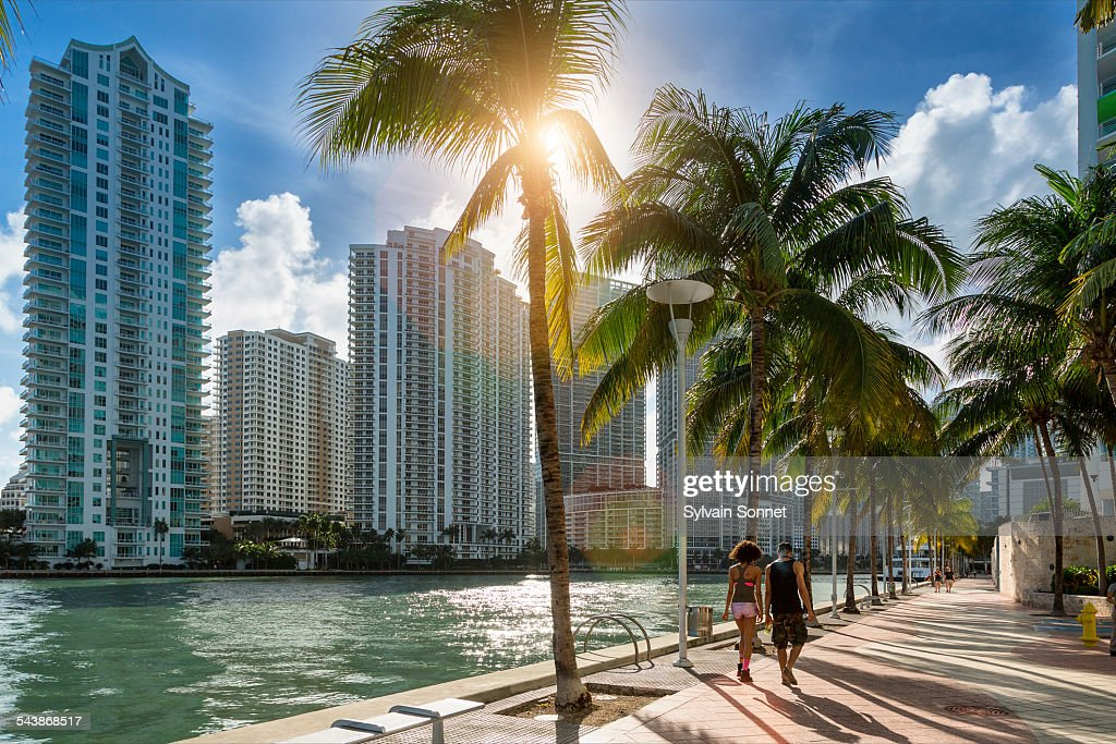 Downtown Miami, people walking along Miami River : Stock Photo