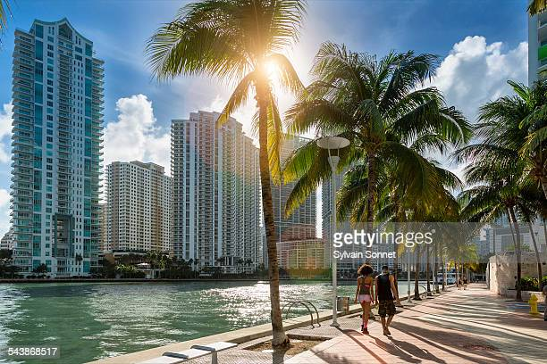 downtown miami, people walking along miami river - downtown miami stock pictures, royalty-free photos & images