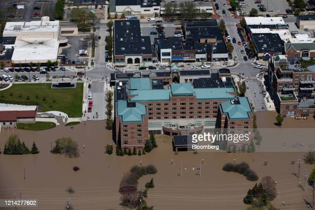 Downtown Midland is seen surrounded by flood water after dams failed in Midland Michigan US on Wednesday May 20 2020 President Donald Trump said he's...