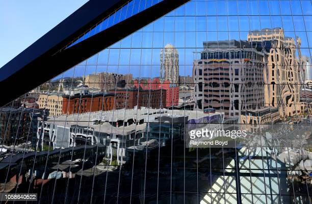 Downtown Minneapolis is reflected off U.S. Bank Stadium, home of the Minnesota Vikings football team in Minneapolis, Minnesota on October 13, 2018.