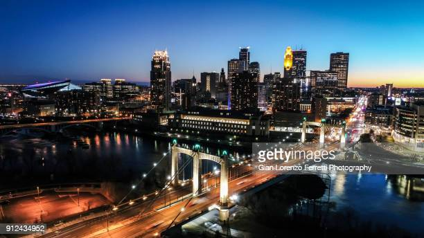 downtown minneapolis skyline & hennepin bridge - minneapolis stock photos and pictures