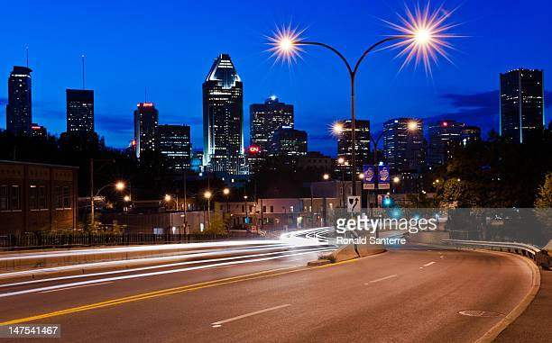 Downtown Montreal at dusk with white trails