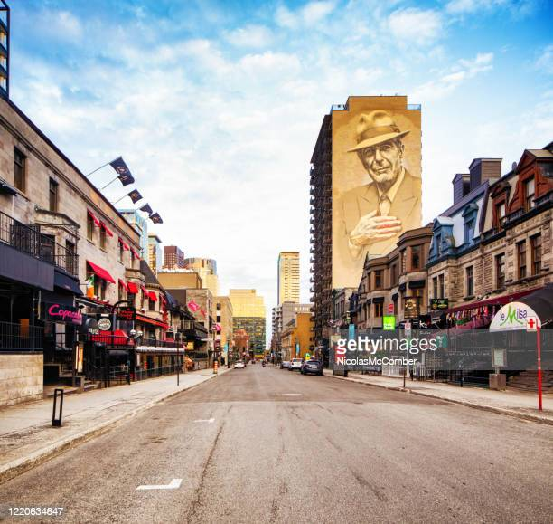downtown montreal crescent street with leonard cohen murale - empty city coronavirus stock pictures, royalty-free photos & images