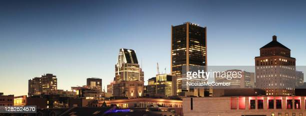 downtown montreal panoramic view at night featuring the tops of office buildings - 20th century style stock pictures, royalty-free photos & images