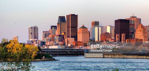 downtown montreal skyline at dawn from the saint lawrence river - 20th century style stock pictures, royalty-free photos & images