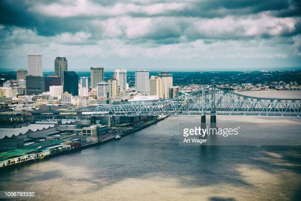 downtown new orleans skyline aerial - mississippi river stock pictures, royalty-free photos & images