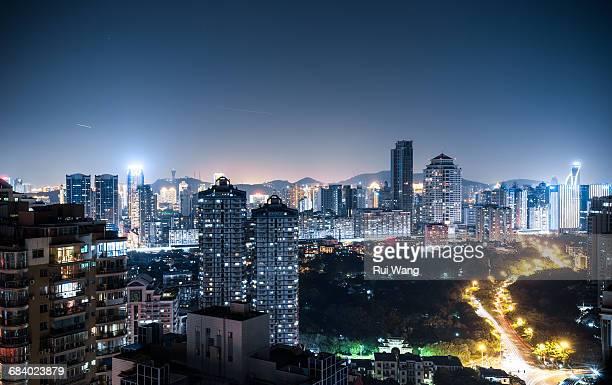 downtown night in xiamen, china - xiamen fotografías e imágenes de stock