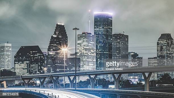 downtown of Houston in the rain at night