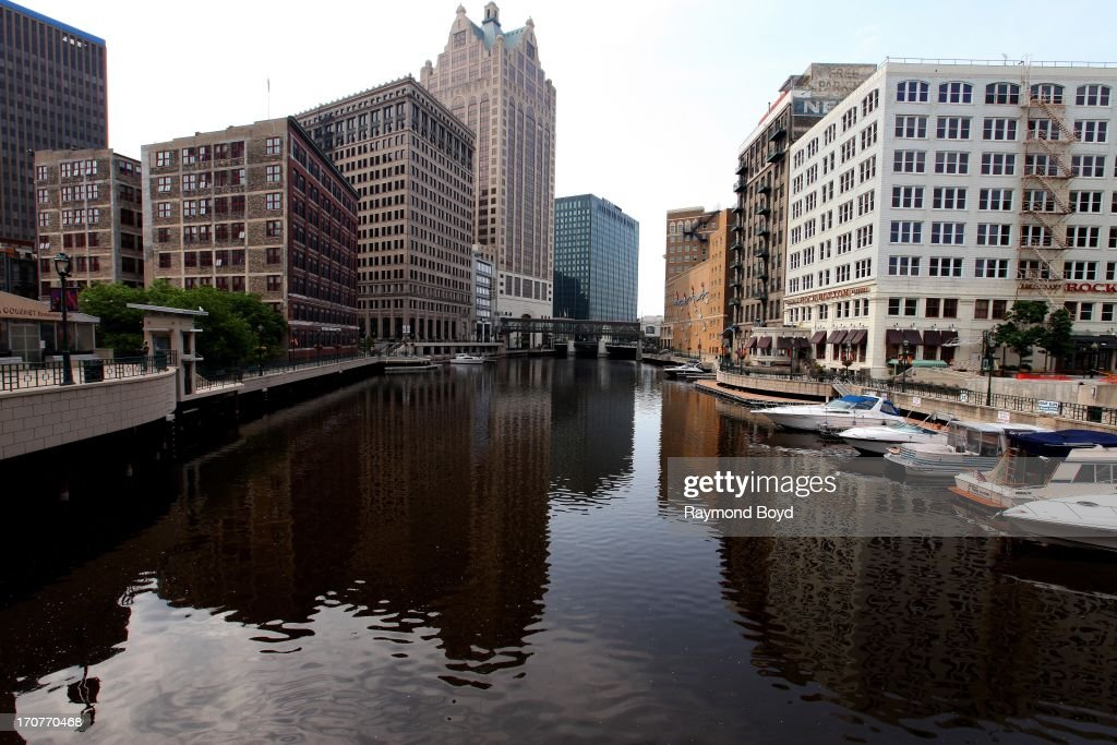 Downtown Office Buildings And Restaurants Along The Milwaukee River In Wisconsin On June