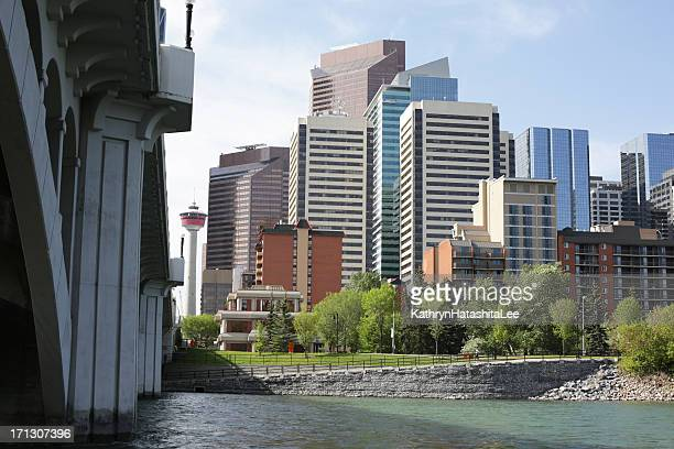 downtown office buildings in calgary, alberta, by the bow river - bow river stock pictures, royalty-free photos & images
