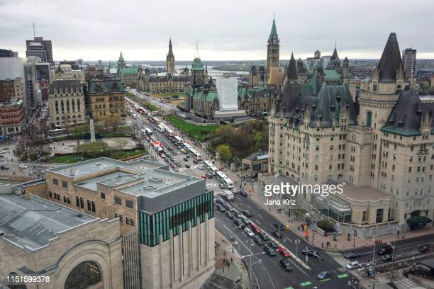 downtown ottawa in the spring viewed from high up. aerial view of chateau laurier and canadian parliament. traffic on wellington - ottawa stock pictures, royalty-free photos & images