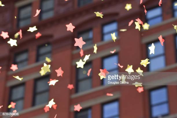 downtown parade confetti falls from the buildings - thanksgiving parade stock photos and pictures