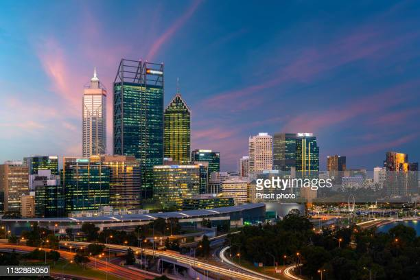 downtown perth city skyline at twilight in western australia, australia. - perth australia stock photos and pictures