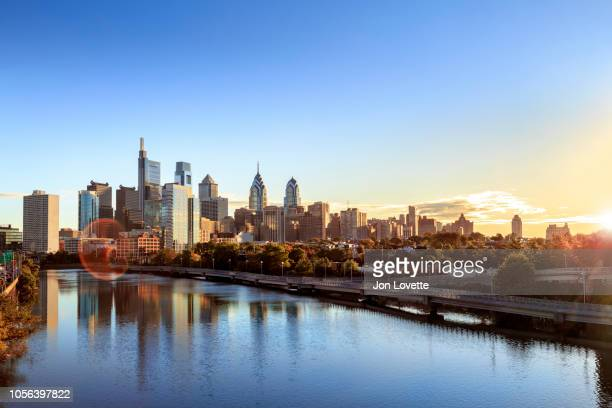 downtown philadelphia skyline with schuylkill river and boardwalk in autumn - philadelphia skyline stock pictures, royalty-free photos & images