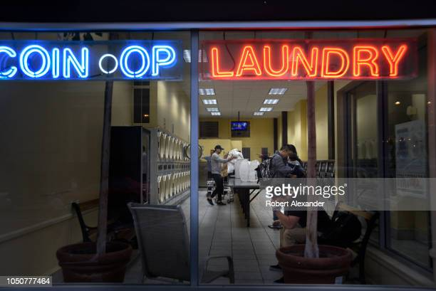 Downtown residents and tourists wash clothes in a self-service laundry, coin laundry or laundromat, in San Francisco, California.