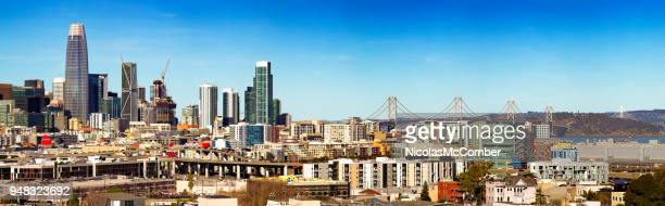 downtown san francisco elevated skyline daytime panorama with bay bridge - bay bridge stock pictures, royalty-free photos & images