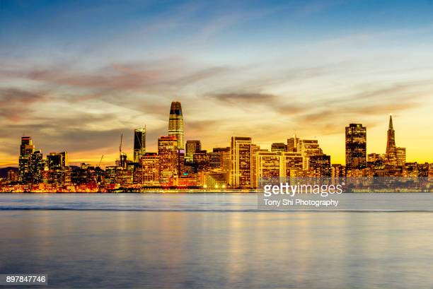downtown san francisco skyline evening glow - treasure island san francisco stock pictures, royalty-free photos & images