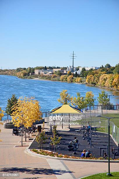 downtown saskatoon river landing along south saskatchewan river - south saskatchewan river stock photos and pictures