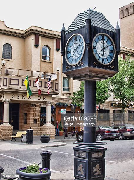 downtown saskatoon with henry birks clock outside jewellery store - saskatoon stock pictures, royalty-free photos & images