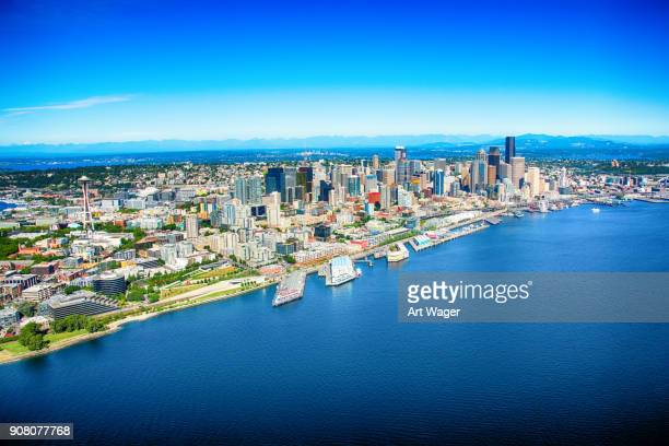 downtown seattle aerial from over puget sound - baia foto e immagini stock