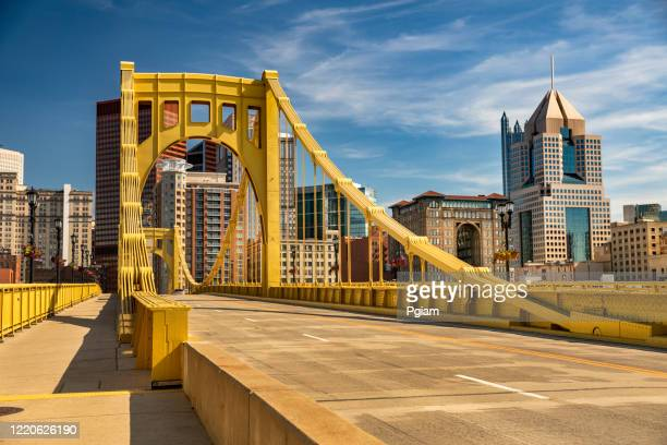 downtown skyline and the roberto clemente bridge in pittsburgh pennsylvania usa - pittsburgh stock pictures, royalty-free photos & images