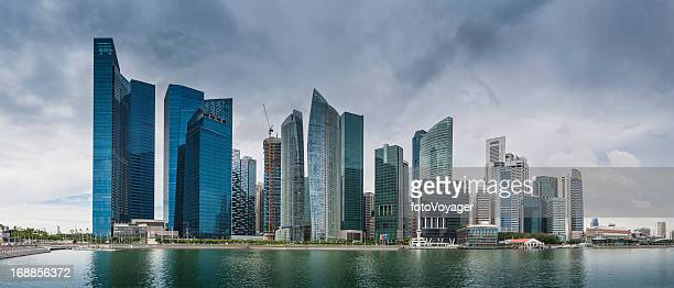 Downtown skyscrapers reflecting in Marina Bay Singapore