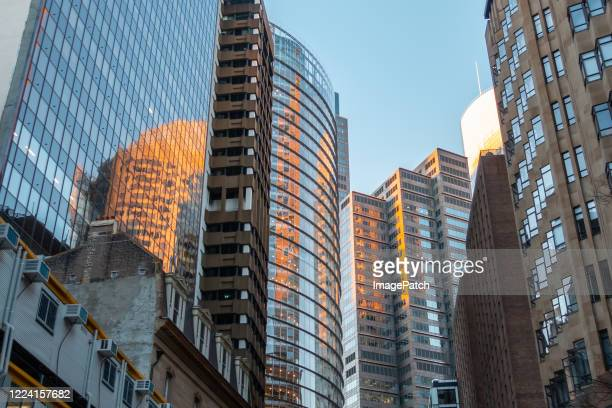downtown sydney street crowded with glass-walled office buildings - downtown stock pictures, royalty-free photos & images