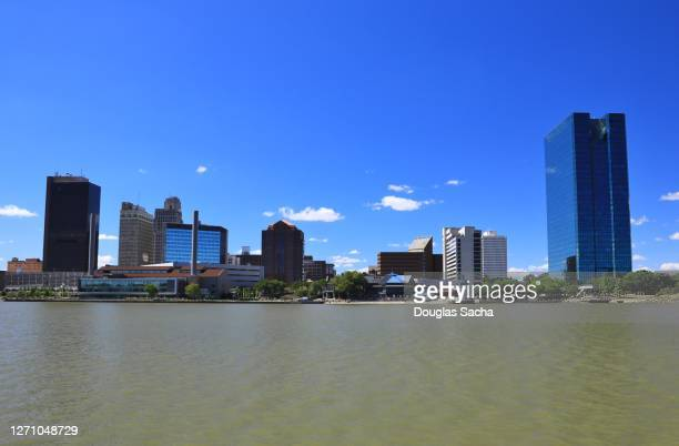downtown toledo skyline on the maumee river - toledo ohio stock pictures, royalty-free photos & images