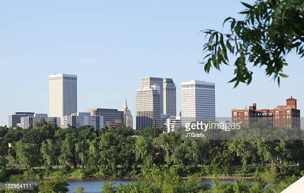 downtown tulsa, oklahoma skyline over arkansas river - tulsa stock pictures, royalty-free photos & images