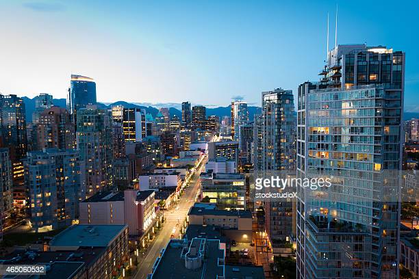 downtown vancouver at dusk - vancouver canada stock photos and pictures
