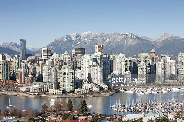 downtown vancouver from false creek - vancouver skyline stock pictures, royalty-free photos & images