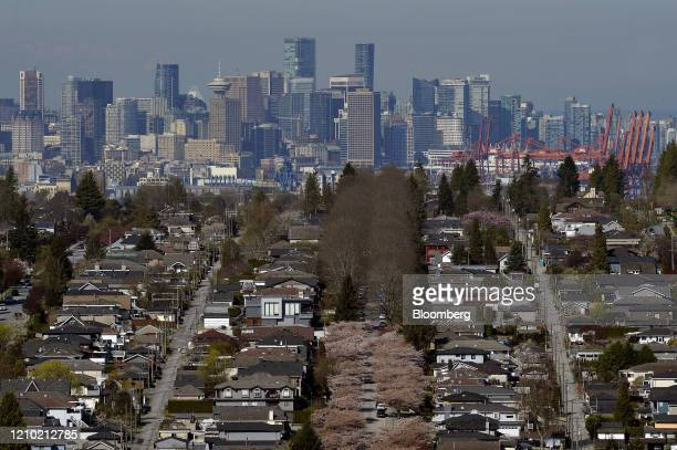 Downtown Vancouver is seen past rows of single family homes in Vancouver British Columbia Canada on Thursday April 16 2020 As its oil sector...