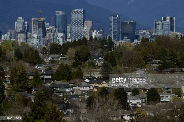Downtown Vancouver is seen past single family homes in Vancouver British Columbia Canada on Thursday April 16 2020 As its oil sector shriveled in...